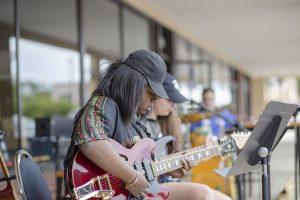 electric guitar player close up