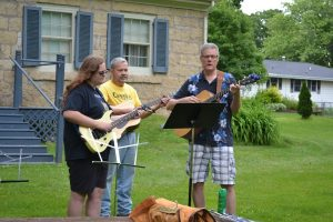 guitar trio in a suburban area
