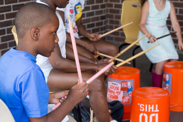 Children drumming on buckets for Make Music Hartford