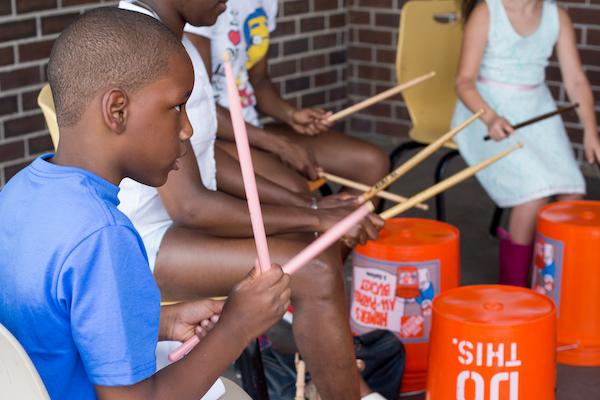 Children drumming on buckets for Make Music Hartford