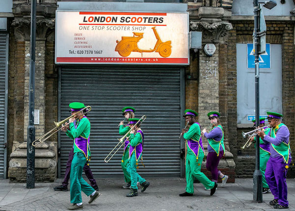 Marching band going down a sidewalk for Make Music Day UK 2019