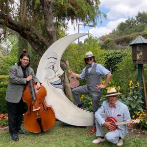Photo of Phil Crosby Jr and band, with stand-up bass, banjo and ukelele