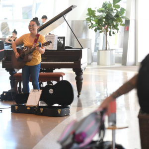 Socorra playing guitar at Airport
