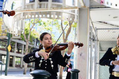 Female Mariachi violin player in downtown San Jose