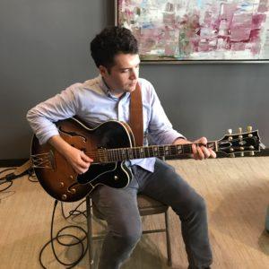 Dan Liparini on his electric guitar.