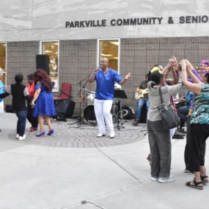 Jose Paulo performing in front of the Parkville Community Center