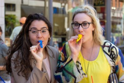 Two guests pose with Kazoos.