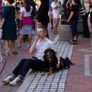 This is a man, his dog, and his kazoo.