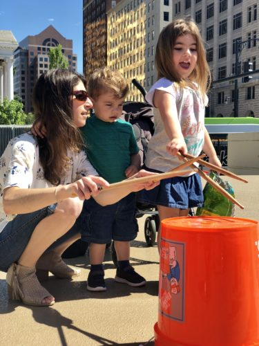 Mom and kids enjoying bucket drumming.