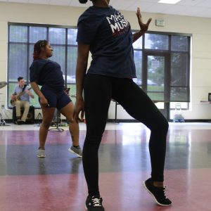 Two dancers are pictured in the middle of a move.